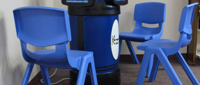 iPad kiosk with blue child-sized chairs
